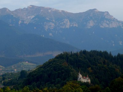 Bran castle set in a mountainous region